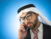 Arabic young businessman  talking on cell phone
