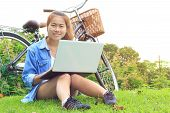 Portrait Asian Woman Use Laptop Computer In The Park, Asia