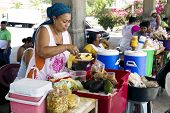 Hispanic woman sells the prepared meal
