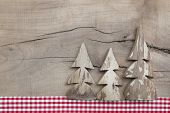 Top View Of Decoration With Three Pine Tree On Wooden Background