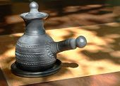 stock photo of loamy  - Arabian style coffee pot on wooden table - JPG