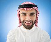 Arabic businessman on blue wall
