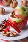 Fresh Red Apple Stuffed With Nuts And Raisins Vertical