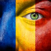 Romanian Flag Painted On A Man's Face