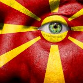 picture of macedonia  - Flag painted on face with green eye to show Macedonia support - JPG