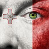 Flag Painted On Face With Green Eye To Show Malta Support
