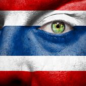 Flag Painted On Face With Green Eye To Show Thailand Support