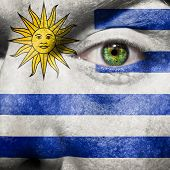 Flag Painted On Face With Green Eye To Show Uruguay Support