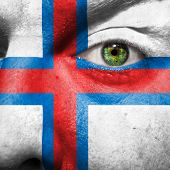 Flag Painted On Face With Green Eye To Show Faroe Island Support
