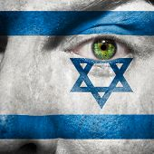 Flag Painted On Face With Green Eye To Show Israel Support