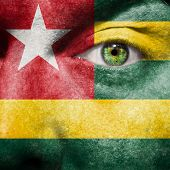 Flag Painted On Face With Green Eye To Show Togo Support