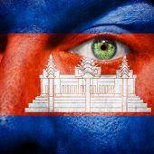 Flag Painted On Face With Green Eye To Show  Cambodja Support