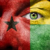Flag Painted On Face With Green Eye To Show Guinea Bissau Support