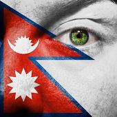 Flag Painted On Face With Green Eye To Show Nepal Support