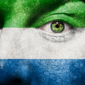 Flag Painted On Face With Green Eye To Show Sierra Leone Support