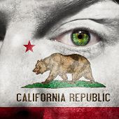 Flag Painted On Face With Green Eye To Show California Support