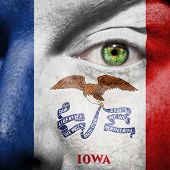 Flag Painted On Face With Green Eye To Show Iowa Support