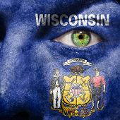 Flag Painted On Face With Green Eye To Show Wisconsin Support