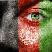 Afghan Flag Painted On A Man's Face