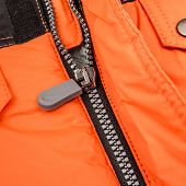 Close up zipper on an orange background