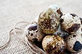 Quail Eggs On Sack Background. Closeup.