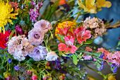 Background of assorted fresh summer flowers in a large bouquet or arrangement in an interior decor a