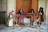 HAMPTON COURT, UK - AUGUST 03, 2014 - Traditional Musicians wearing medieval clothes perform at Hamp