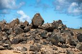 Stone pebbles stacked on the rocks on the beach in Aruba in a simple artistic statement of beaty in