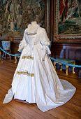 HAMPTON COURT, UK - AUGUST 03, 2014 - White baroque style clothes at Hampton Court Palace near Londo