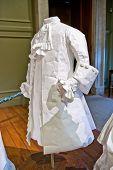 HAMPTON COURT, UK - AUGUST 03, 2014 - White baroque style female dress at Hampton Court Palace near