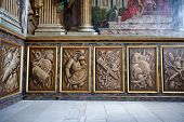 HAMPTON COURT, UK - AUGUST 03, 2014 - Wall decoration at the King's Staircase at Hampton Court Palace near London, UK on August 03, 2014
