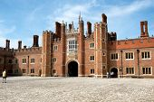 HAMPTON COURT, UK - AUGUST 03, 2014 - Main Court at Hampton Court Palace. Hampton Court Palace is a