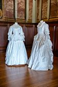 HAMPTON COURT, UK - AUGUST 03, 2014 - White baroque style clothes at Hampton Court Palace near Londo