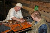 MUSKOGEE, OK - MAY 24: A crafter makes leather and metal armor belt at the Oklahoma 19th annual Rena
