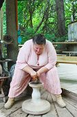 MUSKOGEE, OK - MAY 24: A potter shows of her craft on the spinning wheel at the Oklahoma 19th annual