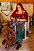 MUSKOGEE, OK - MAY 24:  A woman works at a vintage spinning wheel making yarn at the Oklahoma 19th a