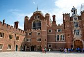 HAMPTON COURT, UK - AUGUST 03, 2014 - Main Court at Hampton Court Palace. Hampton Court Palace is a royal palace in the London Borough of Richmond upon Thames on August 03, 2014