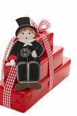 picture of sweeper  - Stack of red Christmas presents with chimney sweeper isolated on white background  - JPG
