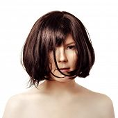Short hair. Young trendy brunette with a black square. Luxury woman with a short hairstyle. Cute girl