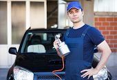 stock photo of gun shop  - Car body repairer holding a spray gun - JPG