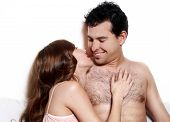 Intimate Young Couple During Foreplay In Bed
