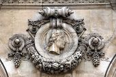 PARIS, FRANCE - NOVEMBER 08, 2012: Architectural details of Opera National de Paris: Percolese Facade sculpture.Grand Opera is famous neo-baroque building in Paris, France. UNESCO World Heritage Site.