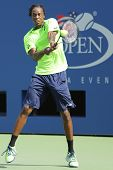 Professional tennis player Gael Monfis practices for US Open 2014