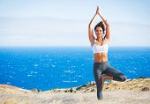 Yoga woman outdoors in nature