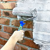 Paint Roller Through A Brick Wall