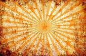Orange Grunge Background With Sun Rays And Stars