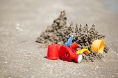Baby Toys Next To A Sand Castle