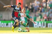 VIENNA, AUSTRIA - JULY 12 Christopher Dibon (#17 Rapid) and Kevin Gameiro (#19 Paris) fight for the