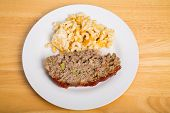 Meatloaf And Macaroni Cheese On Wood Table.jpg
