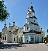 KHARKOV, UKRAINE - JUNE 5, 2014: Prier in front of the Church of the intercession of the blessed virgin. Built in 1689 in Ukrainian Baroque style, the church is now one of the symbols of Kharkov